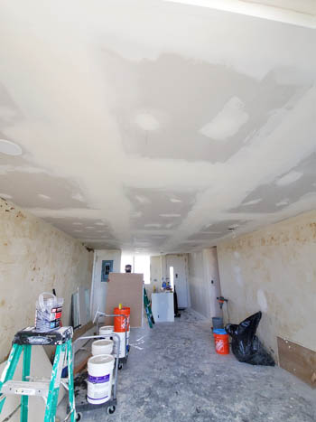 wall removal contractor in Honolulu. The project involved removing a load bearing wall to open up the kitchen.